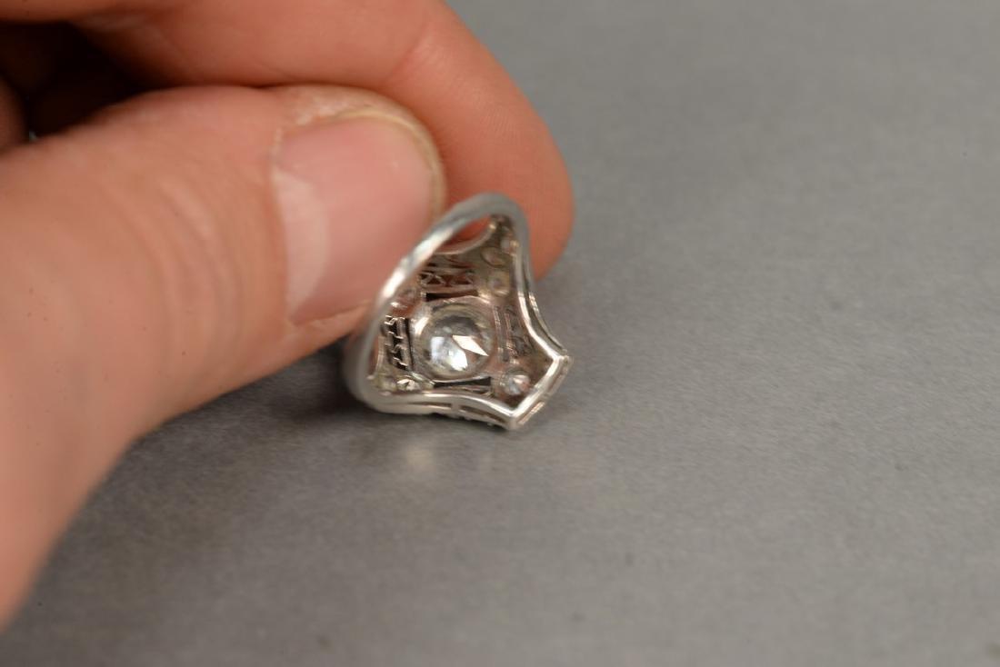 Platinum and diamond ring having center diamond - 9