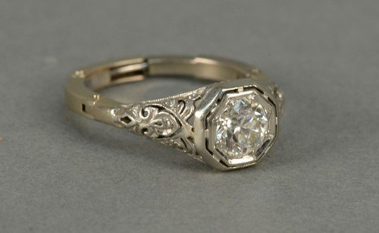 14K gold ring set with center diamond approximately