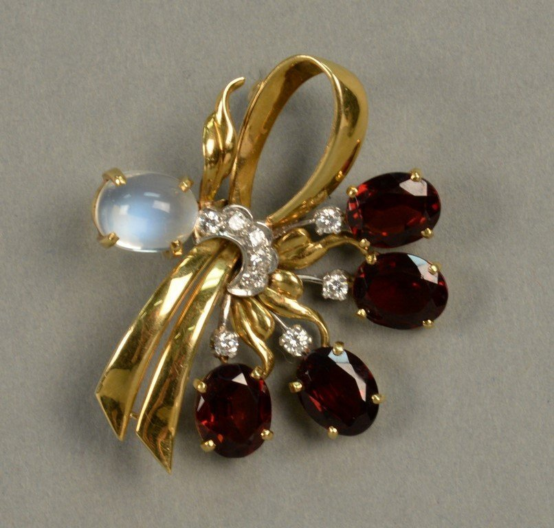 18K gold floral pin set with red stones, eight