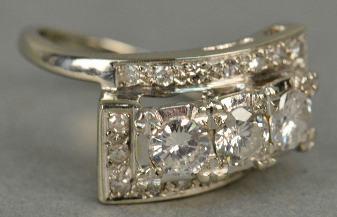 14K ladies ring set with three round diamonds