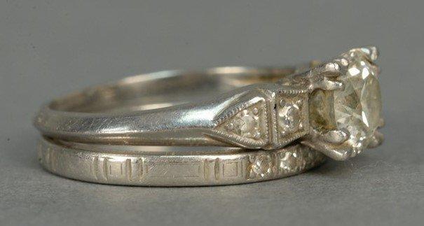 Platinum engagement ring having center diamond