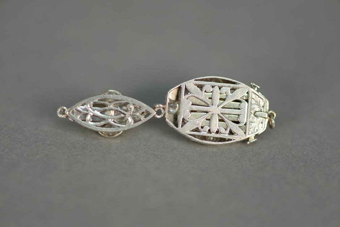 Two necklace clasps, one clasp set with center oval - 6