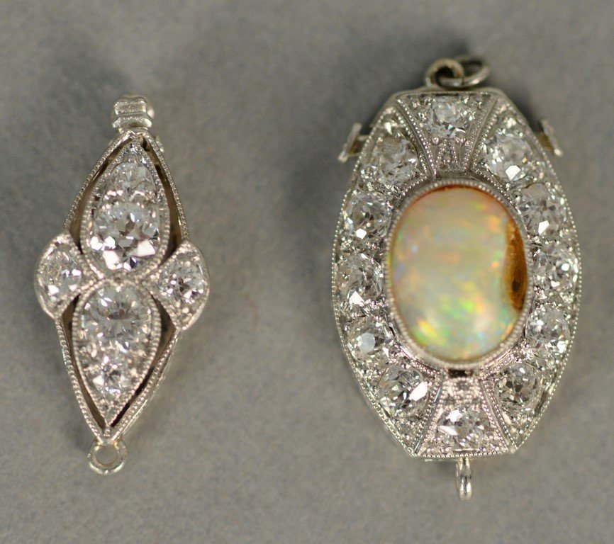 Two necklace clasps, one clasp set with center oval
