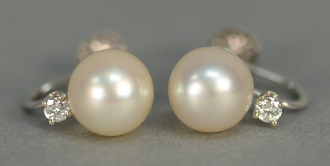 Tiffany & Co. pair of earrings set with pearl and small