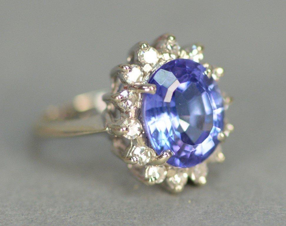 14K white gold ring set with center blue tanzanite