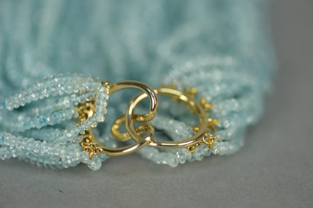 Aquamarine multi-strand bead necklace.  total lg. 17in. - 4