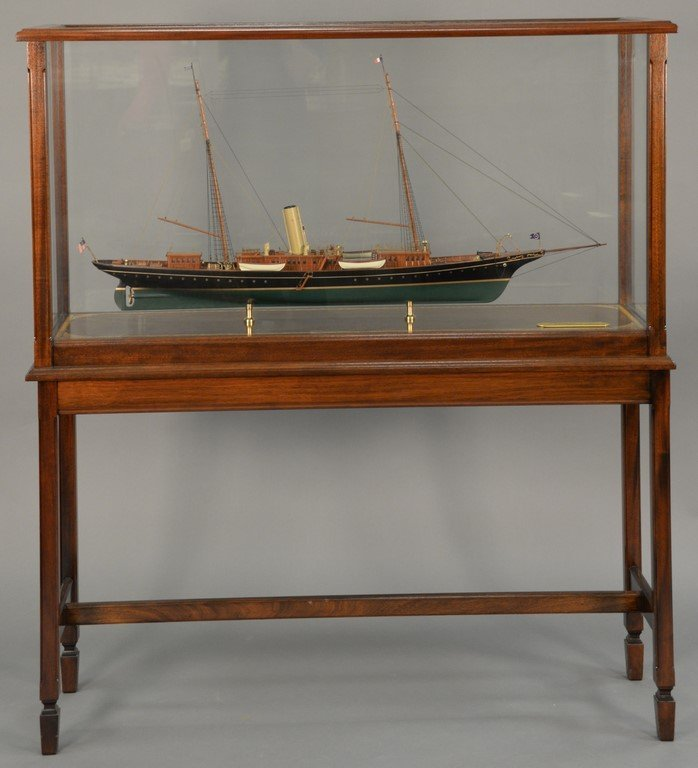 Corsair ship model in mahogany and glass case on