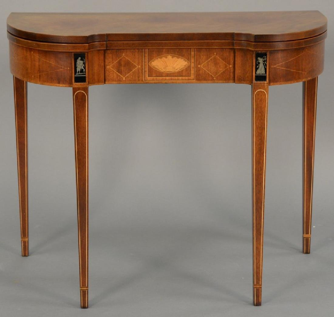 Baker mahogany game table with shaped top over
