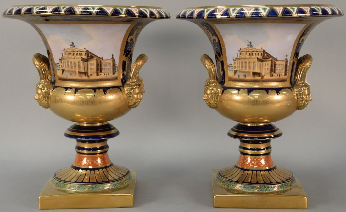 Pair of reproduction urns, gilt decorated with large