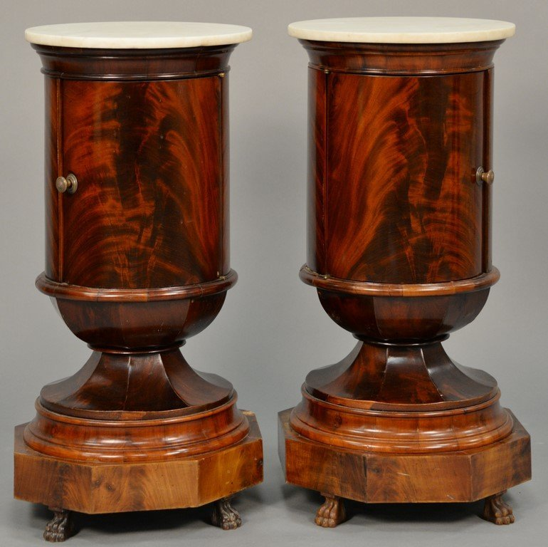 Pair of Empire round mahogany stands having marble tops
