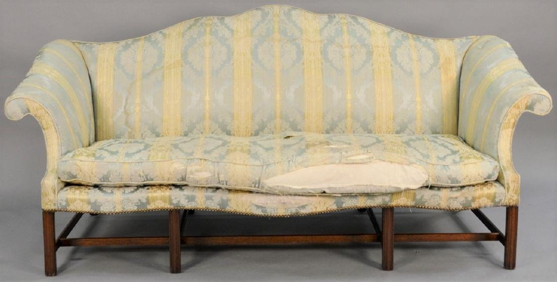 George II sofa having shaped camel back and rolled arms