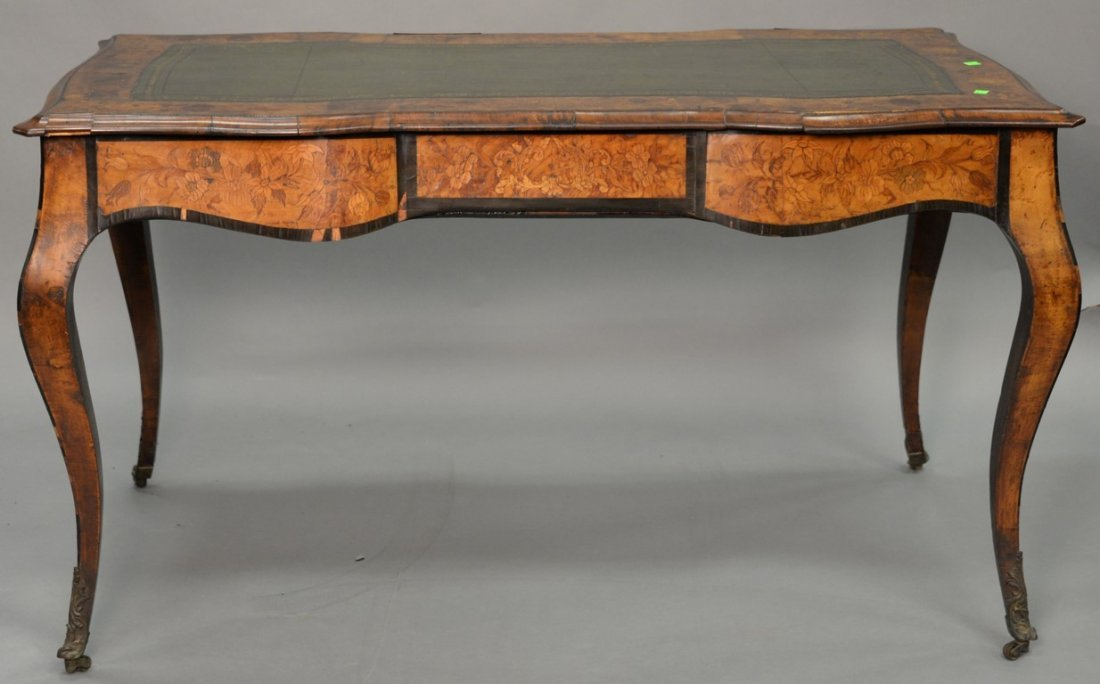 Louis XV style writing table having shaped top with