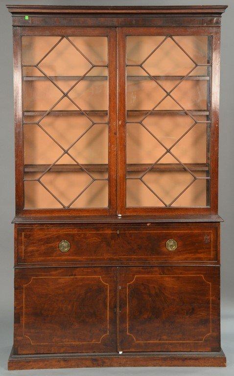 George III mahogany three part bookcase cabinet having