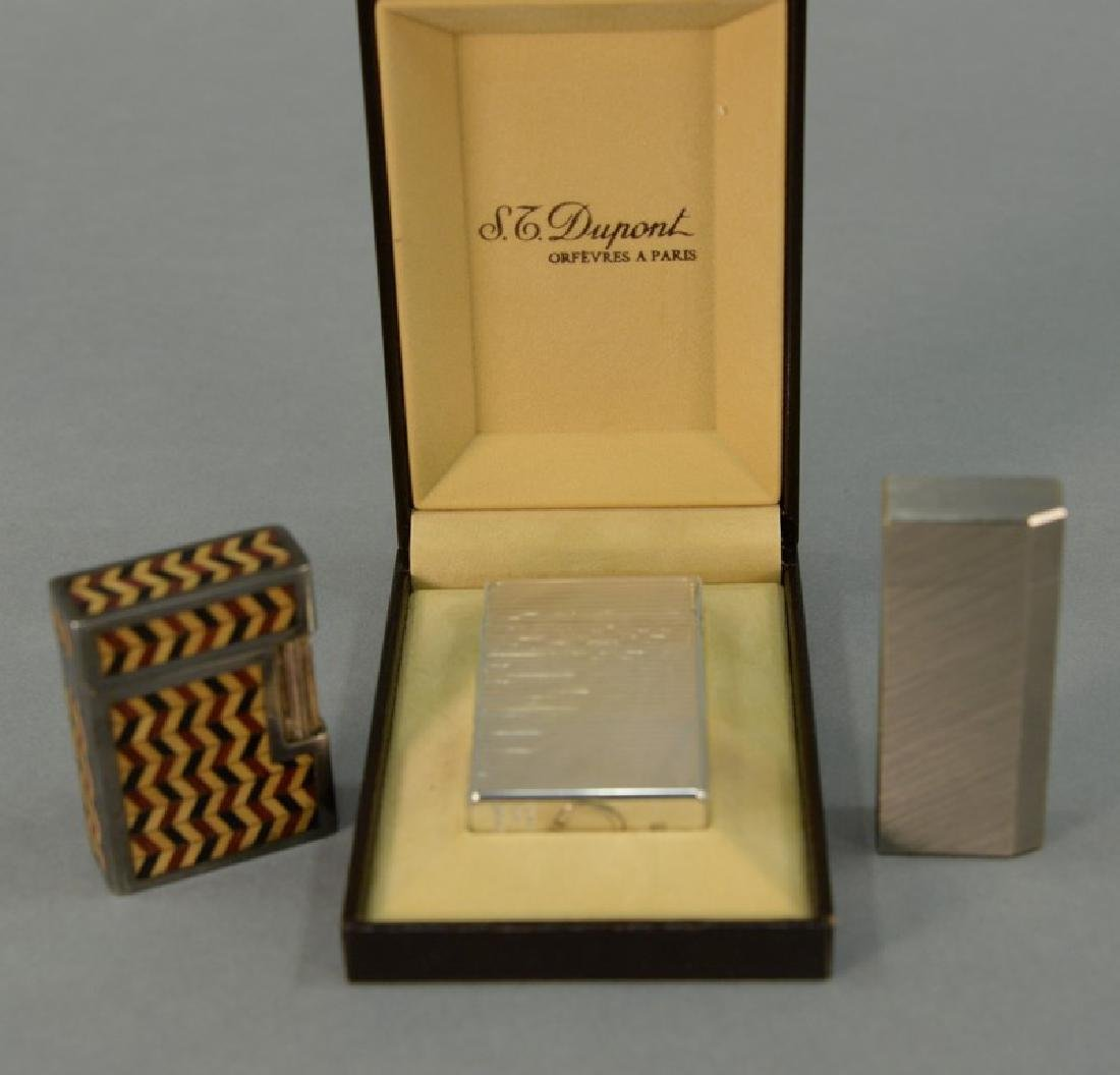 Three lighters including St. Dupont silver lighter