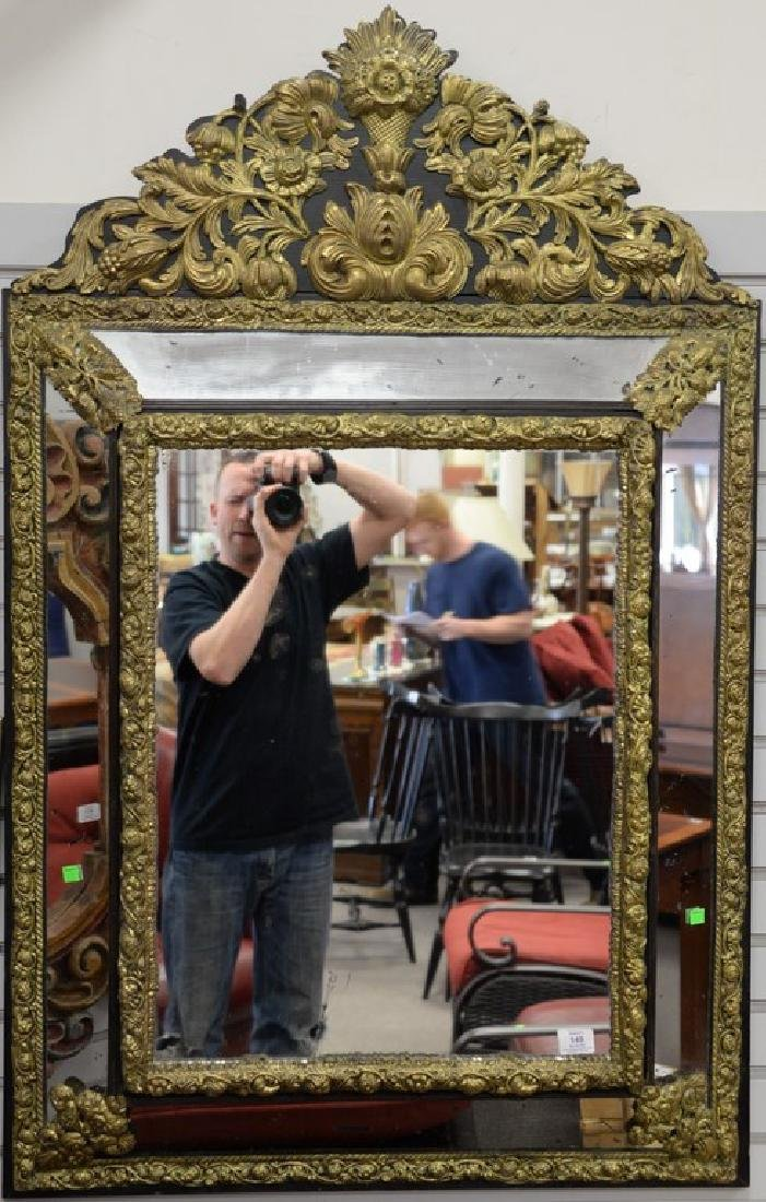 Baroque style embossed brass mirror, ht. 52in., wd. 33
