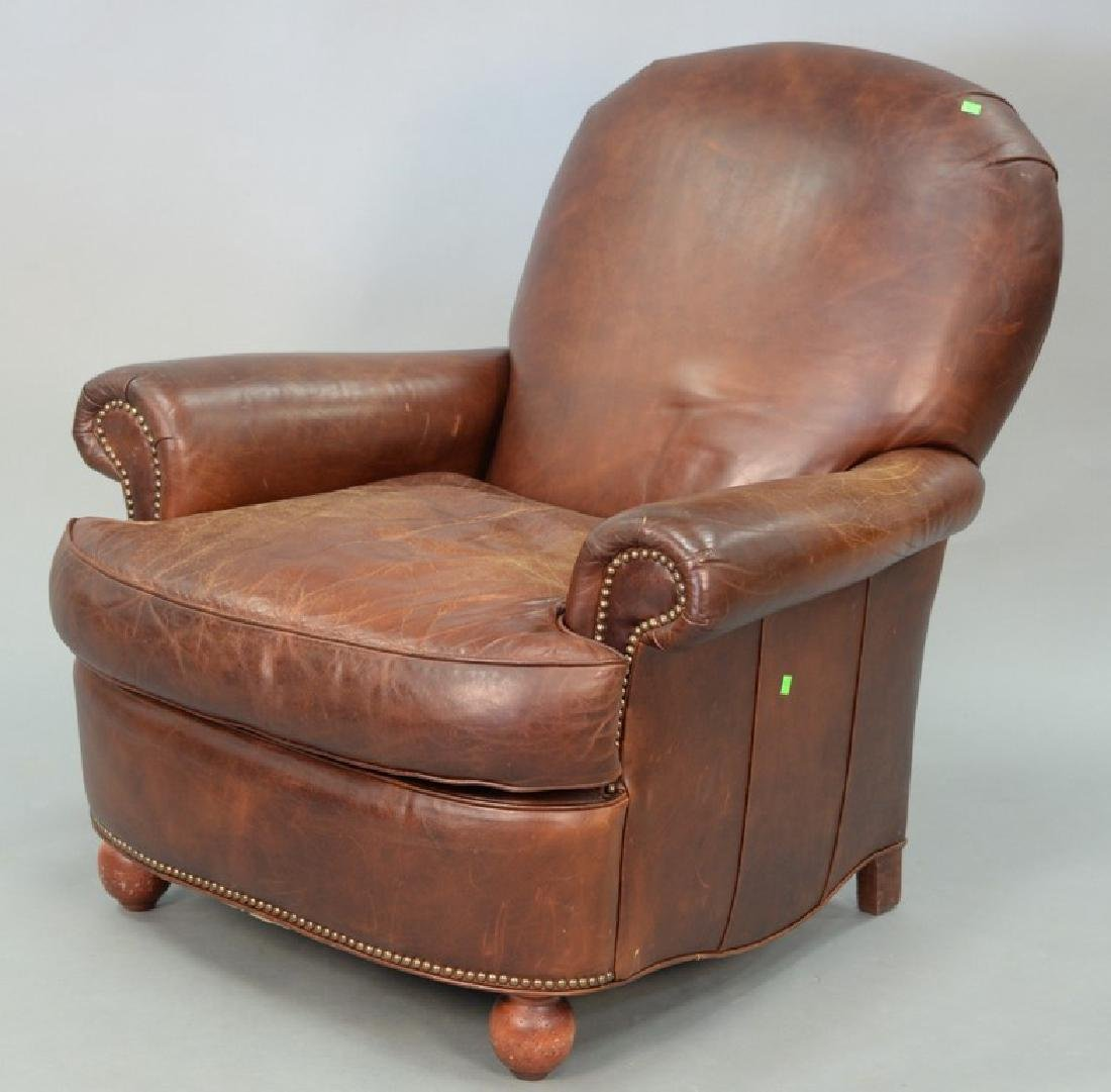 Brown leather easy chair.