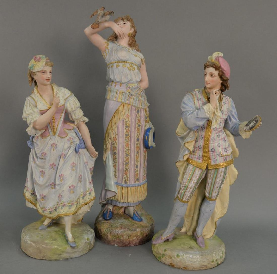 Three large porcelain bisque figures, all elaborately