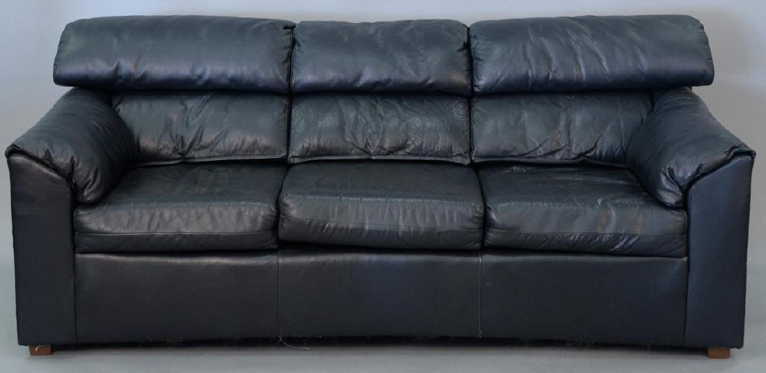 Navy blue three cushion sofa. lg. 78in.