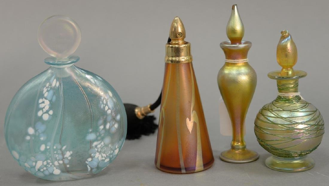 Four art glass perfume bottles to include Loetz gold