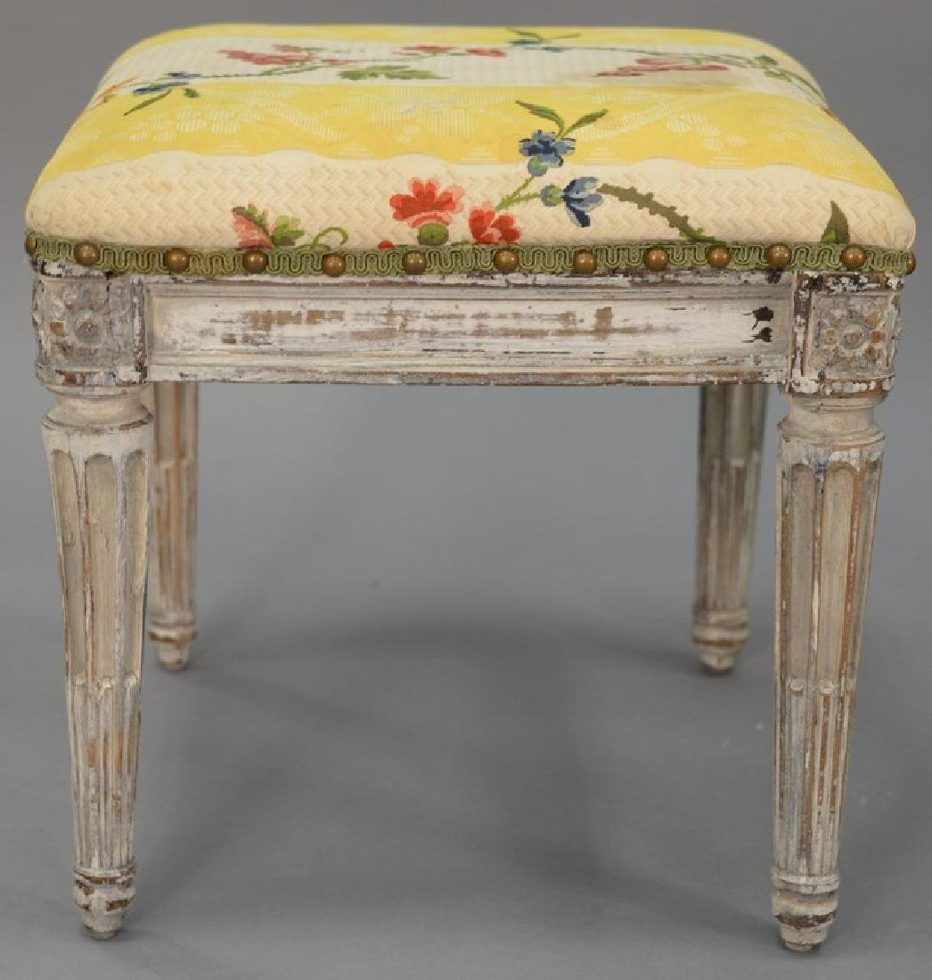Louis XVI stool with upholstered top on carved and