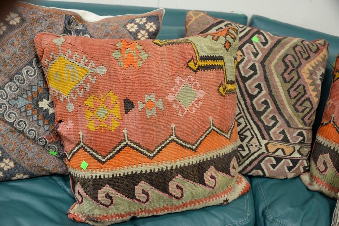 Eight throw pillows, three needlepoint and five Kilim
