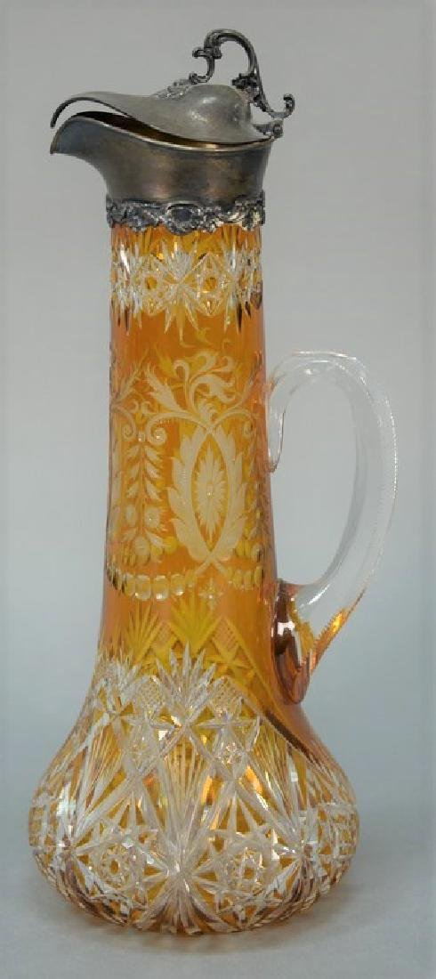 Dark amber cut to clear carafe mounted with Gorham