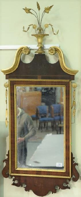 Federal mahogany mirror with gilt urn of flowers and