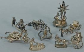 Eight piece miniature silver items to include two horse
