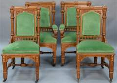 Set of four Victorian oak chairs including two
