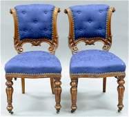 Set of twelve walnut Victorian side chairs having