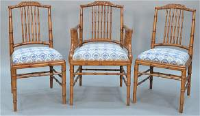 Set of fourteen faux bamboo dining chairs each with