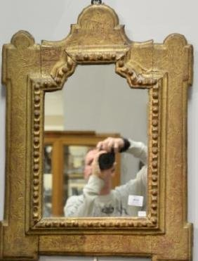 Continental mirror in old gilt with a light floral