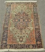 "Sarouk Oriental throw rug. (worn) 3'3"" x 4'6"""
