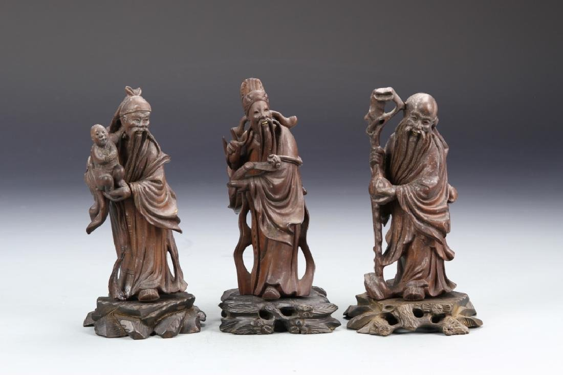 Three Chinese Carved Wood Figurines