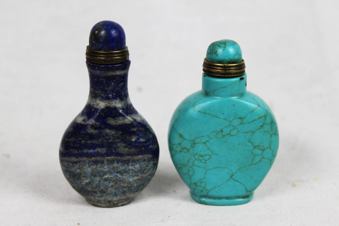 Two Snuff bottles one made with Turquoise