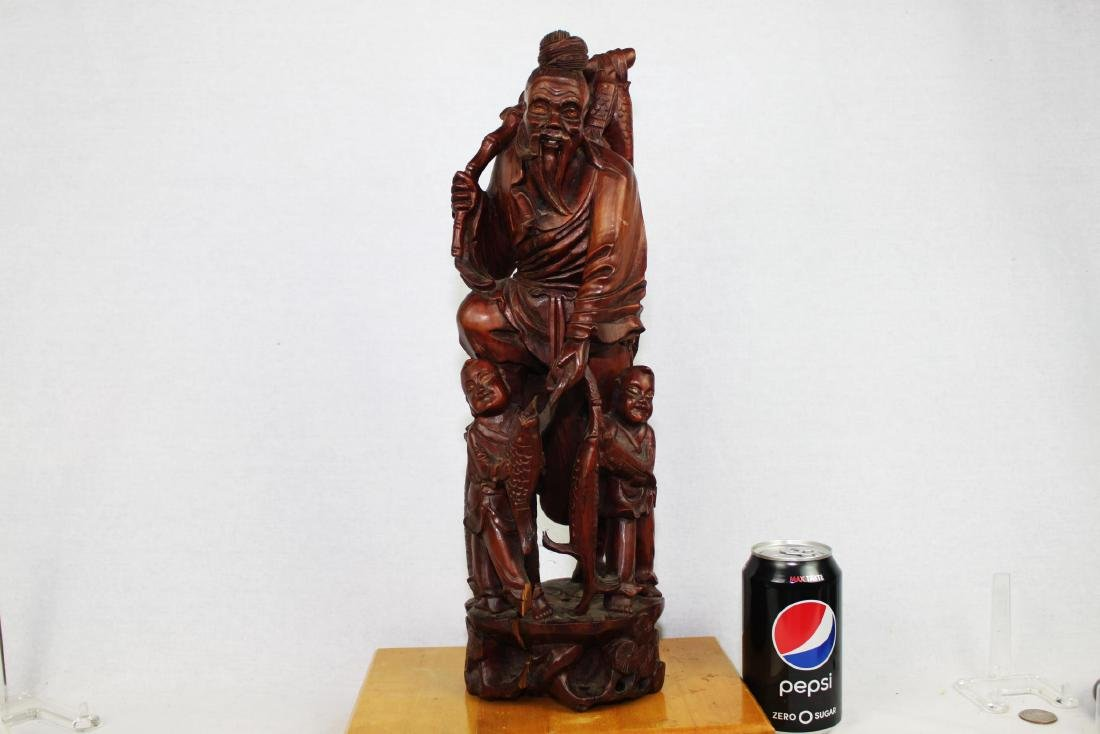 Hand Carved Hard Wood Statue.
