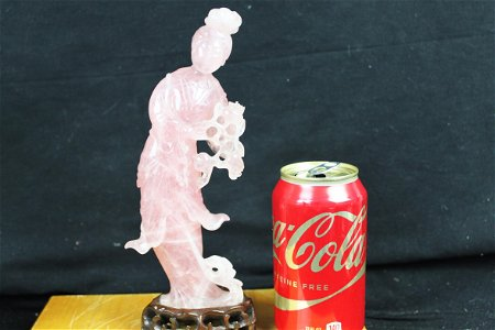 Hand carved pink crystal figure statue