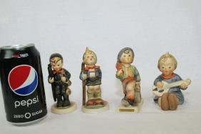 Four of Hummel Goebel Figures.