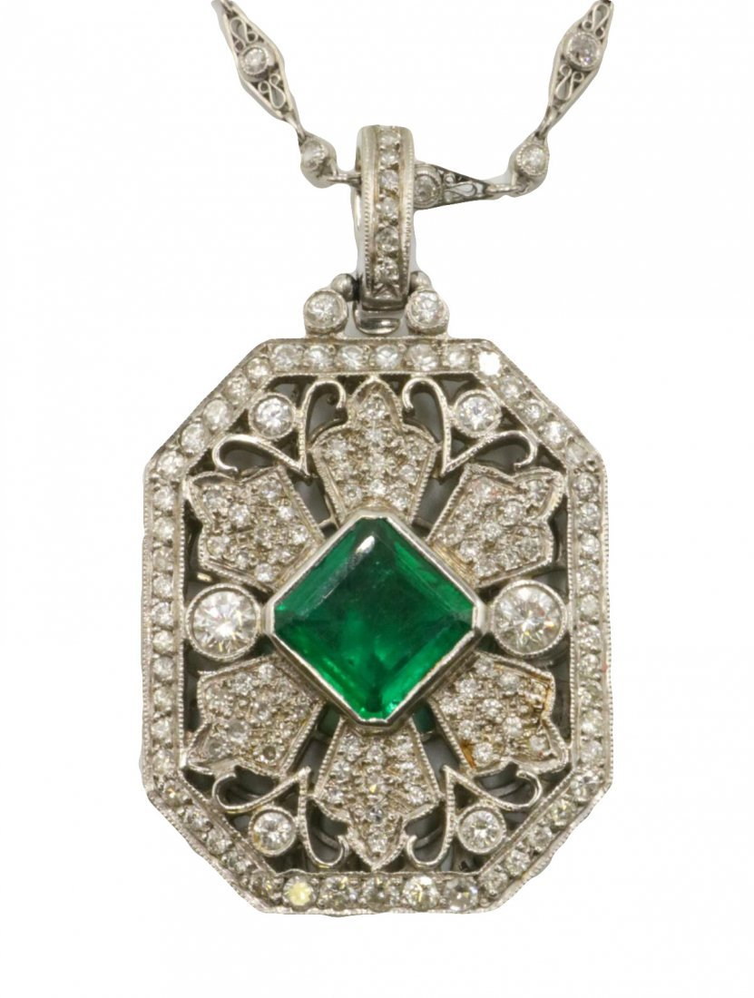 Platinum 4.04ct. Emerald & 4.63ct. Diamond Pendant w/