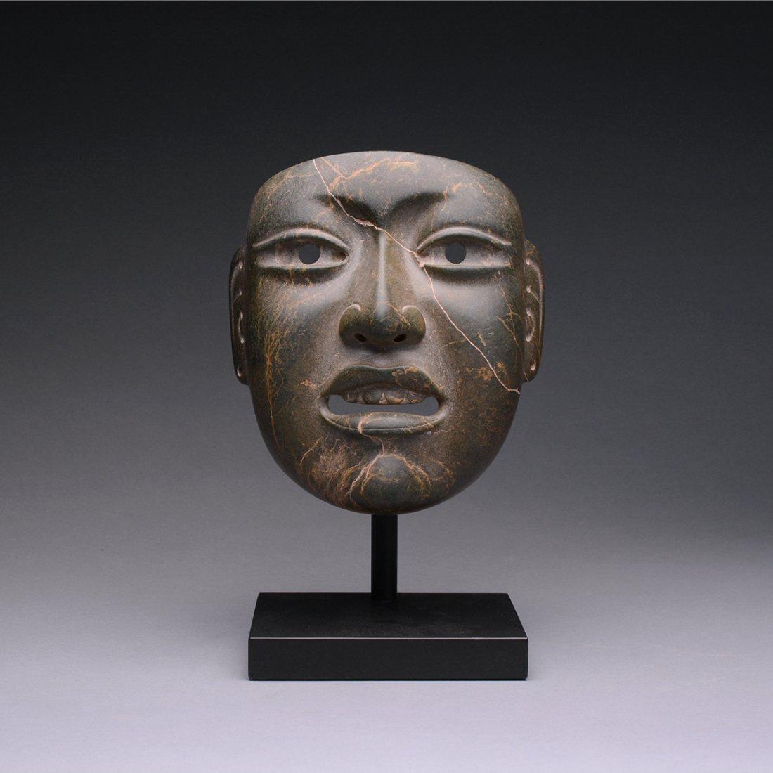 A Fine Olmec Jade Stone Mask