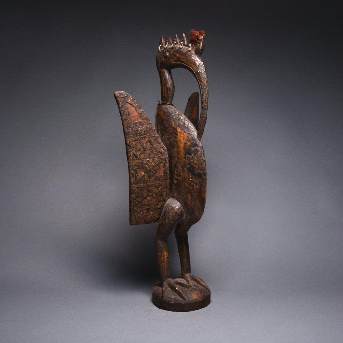 A Senufo Wood and Metal Sculpture of a Bird