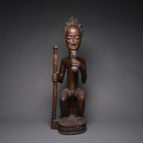 A Baule Wooden Sculpture Of A Seated Cheif