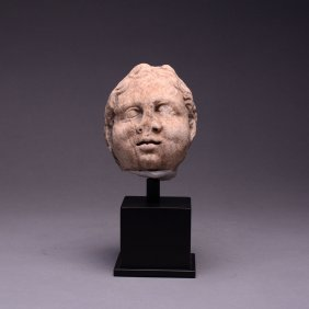 A Roman Marble Head of Eros