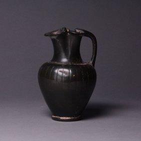 An Apulian Black-Glazed Trefoil Oinochoe