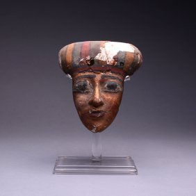 An Egyptian Polychrome Wood Mummy Mask