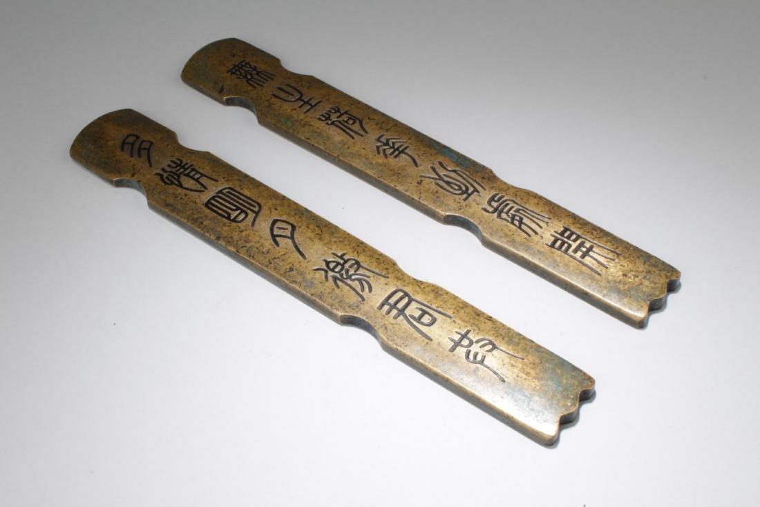A Pair of Estate Chinese Metal-sticks