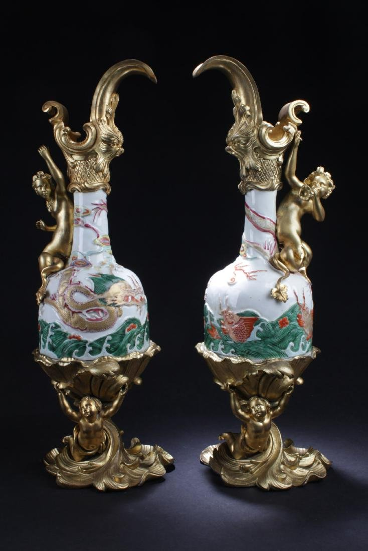 A Pair of Chinese Porcelain Vases, encased with western