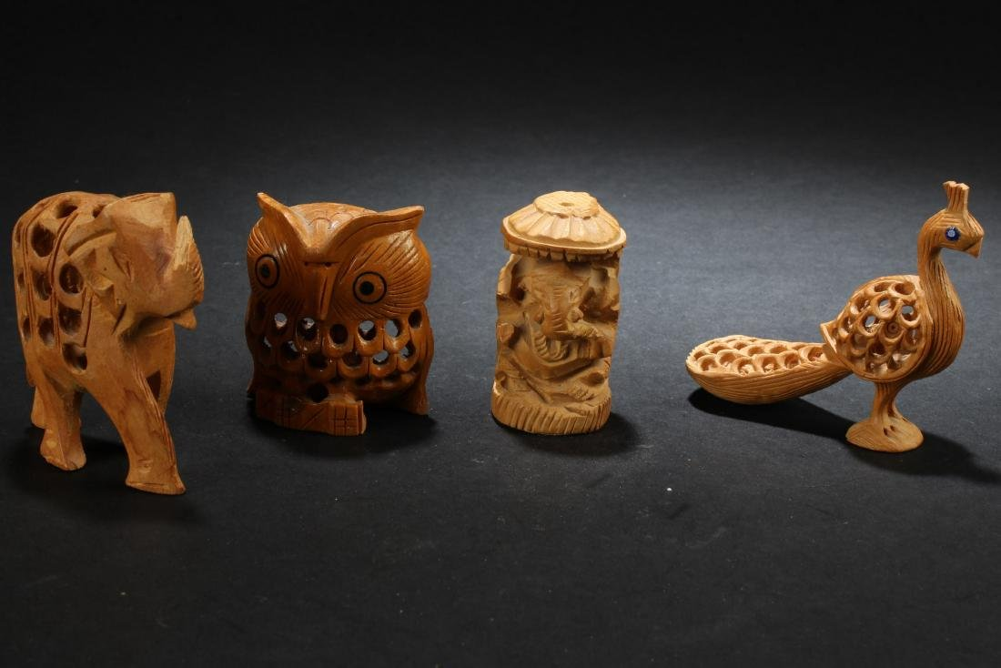 A Group of Four Wooden Carved Ornaments