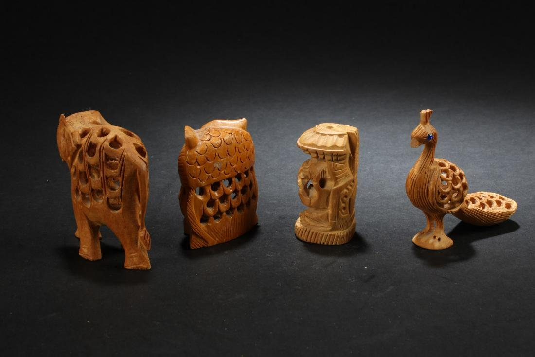 A Group of Four Wooden Carved Ornaments - 2