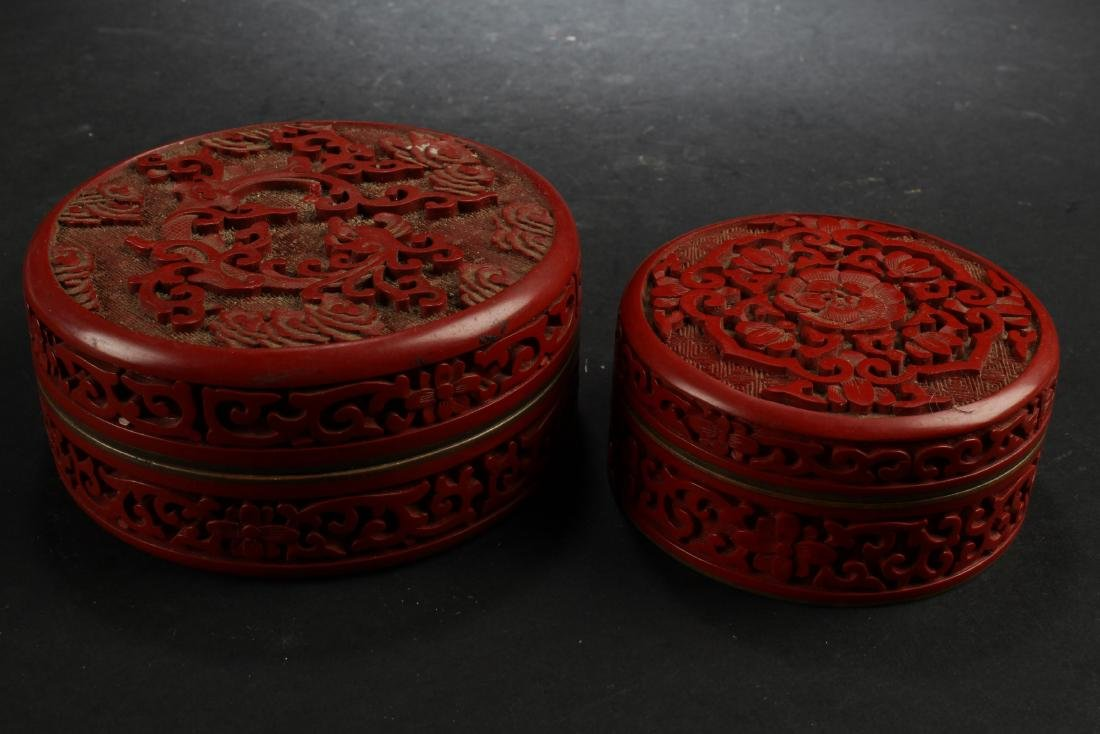 Two Cinnabar Color Porcelain Round Containers